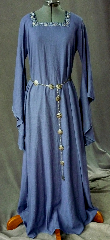 "Gown ID:G712, Gown Color:Dark Periwinkle Blue, Style:12th Century, Sleeve:Long drop sleeve, Trim:2-Tone Blue Floral on neck, Neckline Type:Square, Fabric:Washed Linen, Sleeve Length:26"", Back Length:58""."