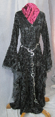 "Gown ID:G715, Gown Color:Black, Style:12th Century, Sleeve:Long Drop Sleeve with black gothic lace at edge, Trim:Black Gothic lace at sleeve edge, Neckline Type:Deep V neck, Fabric:Crushed Velvet, Sleeve Length:31"", Back Length:57""."