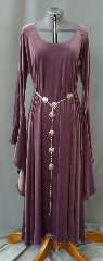 "Gown ID:G719, Gown Color:Mauve, Style:12th Century, Sleeve:Long Drop Sleeve with Narrow Black Lace at edge, Trim:Narrow Black Lace at sleeve edge, Neckline Type:Scoop, Fabric:4-way Stretch Velvet, Sleeve Length:31"", Back Length:52""."