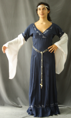 "Gown ID:G726, Gown Color:Stone Blue, white sleeves, Style:12th Century (shown with Diamond Shield Plaque Belt BT0014BZ-ST, and circlet  CT0466EL-ST, not included), Sleeve:Long Drop Sleeve in white cotton, Trim:embroidery, Neckline Type:V-Neck, Fabric:Cotton, Sleeve Length:29"", Back Length:56""."