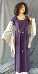 "Gown ID:G731, Gown Color:Dusty Dark Purple with Grey sleeves, Style:12th Century, Sleeve:Long Drop Sleeve in grey polyester with Tapestry Hunt trim at bicep, Trim:Tapestry Hunt trim at bicep, Neckline Type:Ballet, Fabric:Moleskin, Sleeve Length:30"", Back Length:56""."