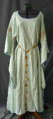 "Gown ID:G734, Gown Color:Pale Foam Green, Style:12th Century, Sleeve:Long Drop Sleeve with Stained Glass Pink and White trim on the bicep. Blue piping on sleeve edge., Trim:Stained Glass Pink and White trim on the bicep. Blue piping on sleeve edge., Neckline Type:Ballet, Fabric:Linen, Sleeve Length:27"", Back Length:57""."