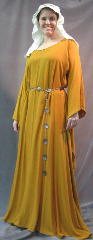 "Gown ID:G742, Gown Color:Mustard Yellow, Style:12th Century, Sleeve:Long drop sleeve, Trim:None, Neckline Type:Ballet, Fabric:Rayon Crepe, Sleeve Length:29.5"", Back Length:55""."