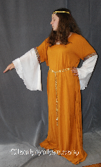 Gown ID:G764, Gown Color:Mustard Yellow, Style:12th Century<br>(shown with CT041558JU circlet and<br>Diamond Shield Plaque<br>Belt BT0014BZ<br>sold separately), Sleeve:Long Drop White Polyester<br> shimmer Sleeve<br>with Celtic knot blue and red<br>trim at bicep, Trim:Celtic knot blue and red trim at bicep, Neckline Type:Scoop, Fabric:Rayon and polyester shimmer sleeves, Sleeve Length:30&quot;, Back Length:58&quot;.