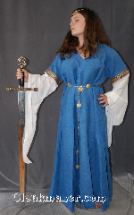 Gown ID:G765, Gown Color:Blue, Style:12th Century<br>(shown with<br>CT190155TH circlet &<br>Quatre Foil Plaque Belt<br>BT0016BZ<br>sold separately), Sleeve:Long Drop White cotton Sleeve<br>with Byzantine Circles, Wide<br> with gold metallic thread<br>trim at bicep, Trim:Byzantine Circles, Wide with gold metallic thread trim at bicep, Neckline Type:V-Neck, Fabric:100% Linen with cotton sleeves, Sleeve Length:33&quot;, Back Length:55&quot;.