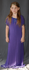 "Gown ID:G909, Gown Color:Purple, Style:Child Dress 12th century, Sleeve:Short Sleeve with Fantasia, Purple/Teal trim, Trim:Fantasia, Purple/Teal trim on the sleeves, Neckline Type:Keyhole trimmed with blue ties, Fabric:Cotton, Sleeve Length:12"", Back Length:45""."