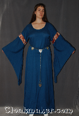 Gown ID:G915, Gown Color:Blue, Style:12th Century<br>(circlet and Silvertone Plated<br>Shell Shield Accolade Belt<br>#BT0020BZ-ST not included), Sleeve:Long Drop Sleeve with<br>Red, Gold, Blue Unique<br>Floral trim on bicep, Trim:Red, Gold, Blue Unique<br>Floral trim on bicep, Neckline Type:Scoop, Fabric:Cotton Blend<br>Machine Washable, Sleeve Length:31&quot;, Back Length:60&quot;.