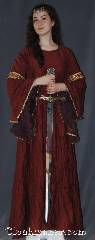 Gown ID:G919, Gown Color:Maroon, Style:12th Century<br>(Pictured with circlet<br>CT020151TH-ST<br>and belt BT0013ST sold<br>separately), Sleeve:Long Drop Sleeve with<br>Rusty Diamonds (Orange/Red/Gold)<br>trim on bicep<br>Gold picot lace on sleeve edge, Trim:Rusty Diamonds (Orange/Red/Gold)<br>trim on bicep<br>Gold picot lace on sleeve edge, Neckline Type:Scoop, Fabric:Polyester, Sleeve Length:30&quot;, Back Length:56&quot;.