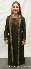 Gown ID:G936, Gown Color:Brown with Green gold cross trim, Style:12th Century youth, Sleeve:Long with Cross trim cuff, Trim:Cross trim on front and cuff <br>Gold, Green, White, Brown, Neckline Type:Scoop, Fabric:Cotton Lycra, Chest Measurement:30&quot;, Sleeve Length:28&quot;, Back Length:47&quot;.
