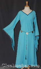 Gown ID:G948, Gown Color:light blue, Style:12th Century<br>(shown with<br>Silvertone Plated Shell Shield Accolade<br>Belt Item #BT0020BZ-ST <br>sold separately), Sleeve:Long drop sleeve<br>with red and amber celtic knot<br>on black edge, Trim:Running Mosaic Vine sleeve, Neckline Type:V-Neck with Blue bias trim, Fabric:Linen look rayon poly, Hip:Neck 24&quot;, Sleeve Length:28.5&quot;, Back Length:53.5&quot;.