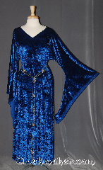 "Gown ID:G950, Gown Color:Blue, Style:12th Century, Sleeve:Long Drop sleeve, Trim:None, Neckline Type:V-Neck, Fabric:Crushed Velvet stretch, Back Length:53""."