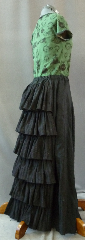 "Skirt:K129, Skirt Color:Black with 6 black & silver ruffles, Skirt Style:Victorian Back Ruffle, Length:39"", Waist:up to 44""."