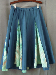 "Skirt:K236, Skirt Color:Teal with soft green silk tie-dye gores, Skirt Style:Dance skirt, Length:31"", Waist:up to 41"" elastic."