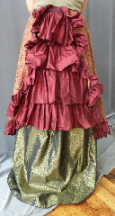 "Skirt:K251, Skirt Color:Magenta, Skirt Style:4 - Tiered Victorian Back Ruffle Panel (bustle), Length:26"", Waist:Panel Width 16"" (ties around the waist)."