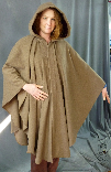 A woman in a heathered light brown wool Cape/Ruana, which can be made in fleece and other fabrics in other colours.