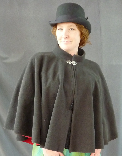 A lady's short cloak or mantle made of black windpro, a wind resistant material which is great for winter fall and spring.
