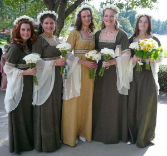 A wedding photo of a bridal party wearing custom-made (12th century) bridesmaid's gowns.