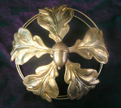 A unique handmade soldered brass bun cover decorated with oak leaves and acorns.