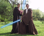 Two men dressed as Jedi in replica Obi Wan Kenobi and Anakin costumes from the Star Wars trilogy.