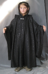 "Robe:R186, Robe Style:Ritual Robe or Mage Robe, Robe Color:Black Sparkle, Front/Collar:Hooded with Antiquity clasp, Approx. Size:Youth 5 - 8 years old, Fiber:100% Polyester, Neck:20.5"", Sleeve:23"", Length:36"", Height:Up to 4'."