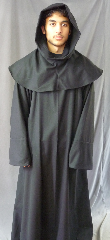 "Robe:R243, Robe Style:Monk's Robe with attached hooded cowl, Robe Color:Black, Front/Collar:Round neck, Fiber:Thin Flat Weave Wool, Neck:23.5"", Sleeve:36"", Chest:Up to 60"", Length:67"", Height:Up to 6' 7"", Note:Rope Belt and Pouch (not shown) are included. Dry Clean Only.."