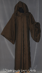 Robe:R303, Robe Style:Qui Gon Jin Robe, Robe Color:Brown black tight chevron, Front/Collar:Hooded with Brown cloth-covered hook and eye, Fiber:Wool Polyester Blend, Neck:25&quot;, Sleeve:34.5&quot;, Chest:66&quot;, Length:61&quot;, Height:Up to 6&#039; 1&quot;. Can be shortened, Note:Comfortable to wear around<br>the house and around town.<br>This hooded robe is made of a<br>light weight two tone wool/polyester<br>with brown cloth-covered<br>hook and eye clasp<br>with pointed sleeves is<br>modeled after Qui Gon.<br>Can be converted to Anakin as well.<br>Machine Washable on gentle,  line dry.
