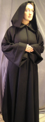 "Robe:R43, Robe Style:Traveler's Robe, Robe Color:Black, Front/Collar:Hooded with Obiwan style cuff, Approx. Size:TBD, Fiber:Wool Flannel, Neck Length:21"", Sleeve:37"", Chest:40"", Length:57"", Height:5'7"", Note:$199 and up depending on fabric and size."