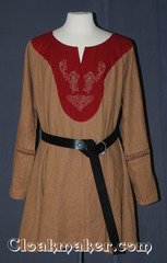 tan/red Tunic with contrasting red fabric and celtic horse and dragon knot embroidery trimmed with 3-strand celtic braid, large burgundy/tan trim